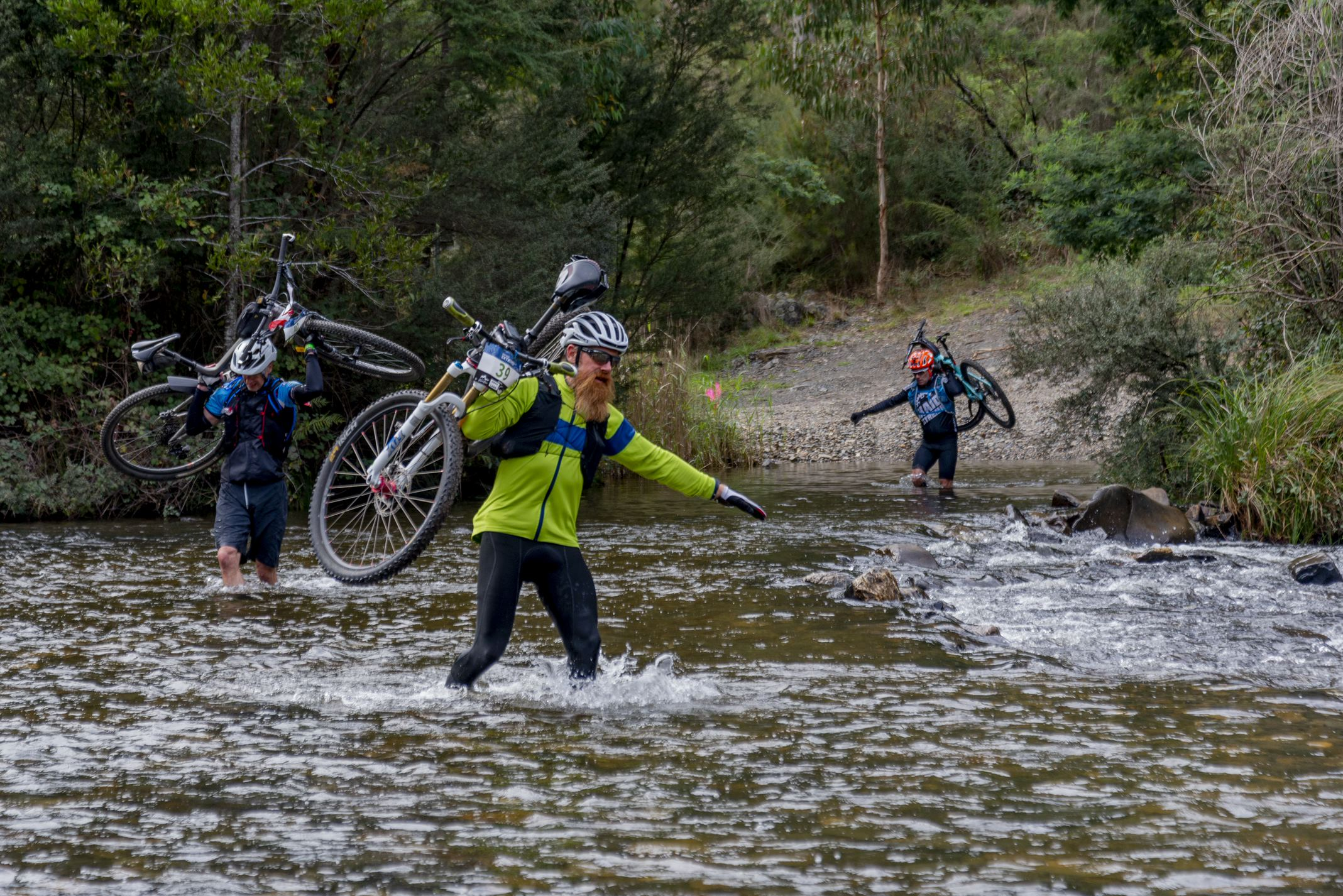 participants crossing Thomson river